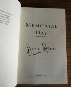 One of my copies of Memorial Day, signed by the author, Vince Flynn