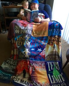 Me and my youngest son, Ryan Jr reading Memorial Day by Vince Flynn