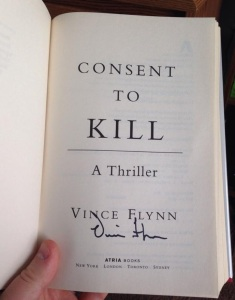 One of my several copies of Vince Flynn's novel Consent to Kill